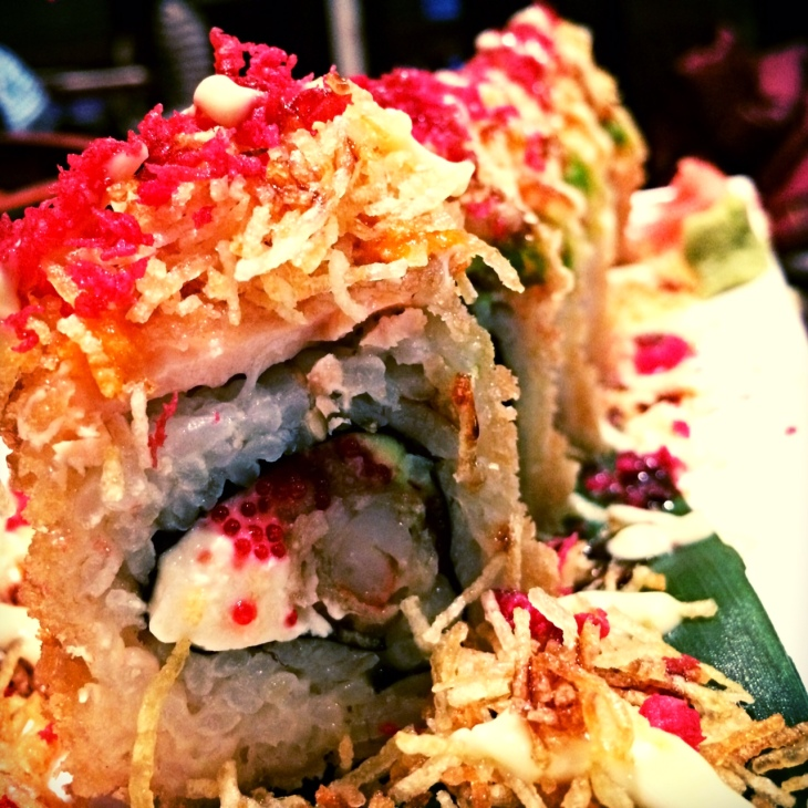 Deep fried roll with shrimp, salmon, avocado,  fish row, philidelphia cheese and potato bits
