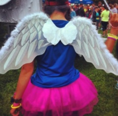 "Day 26: Monika. The woman who was mocked in Self Magazine because she wore a tutu, has definitely taken the high road. She has handled the situation with such class. The angry energy towards the mag? She asked people instead to send message to young girls about perseverance. I completely forgot to wear my tutu yesterday but here's a pic of me at a 10km race last summer. I was a ""coaching fairy"" for a friend."